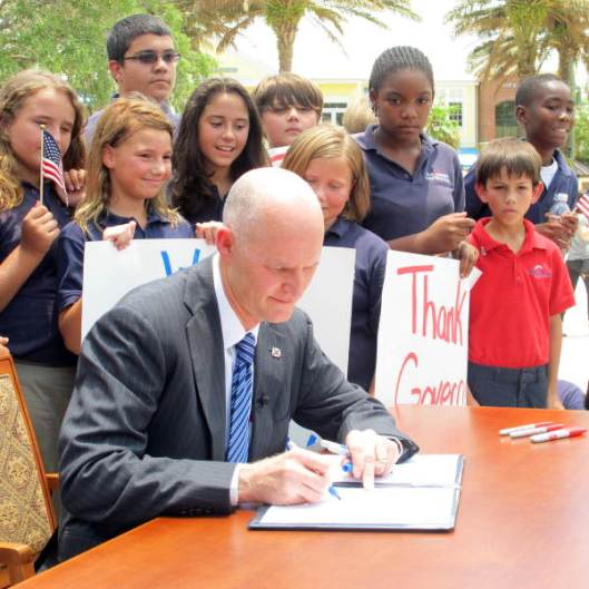 Governor Rick Scott signing the $69 billion state budget for fiscal 2011-12 at The Villages in Sumter County, Florida. State Archives of Florida, Florida Memory, http://floridamemory.com/items/show/241861