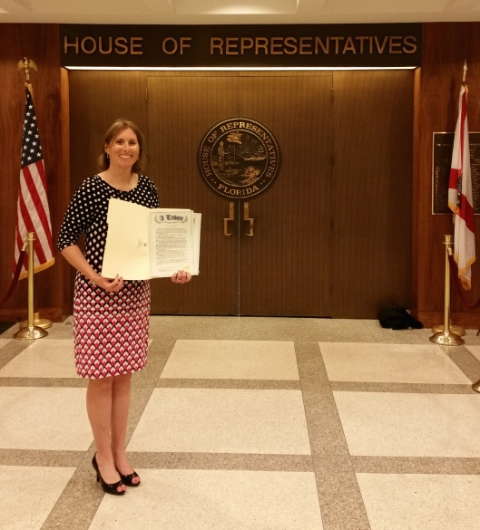 Teacher Cathy Fernandez holds the Resolution declaring January 30, 2016 and every January 30 thereafter will be known as Fred T. Korematsu Day in the state of Florida in honor of his fight for civil liberties and to remember to stand up for the civil liberties for all.